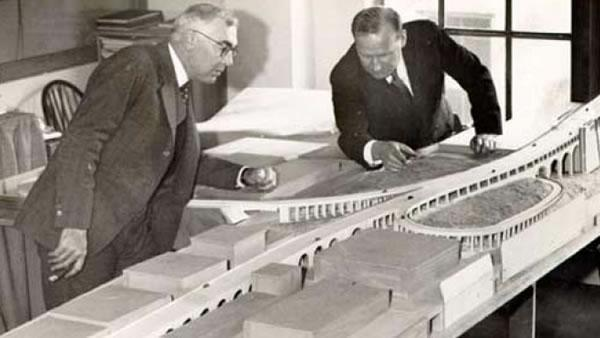 San Francisco Architect Timothy L. Pflueger and Chief Engineer C. H. Purcell are looking at a model of an approach to the San Francisco-Oakland Bay Bridge in 1933. (Photo courtesy baybridgeinfo.org)
