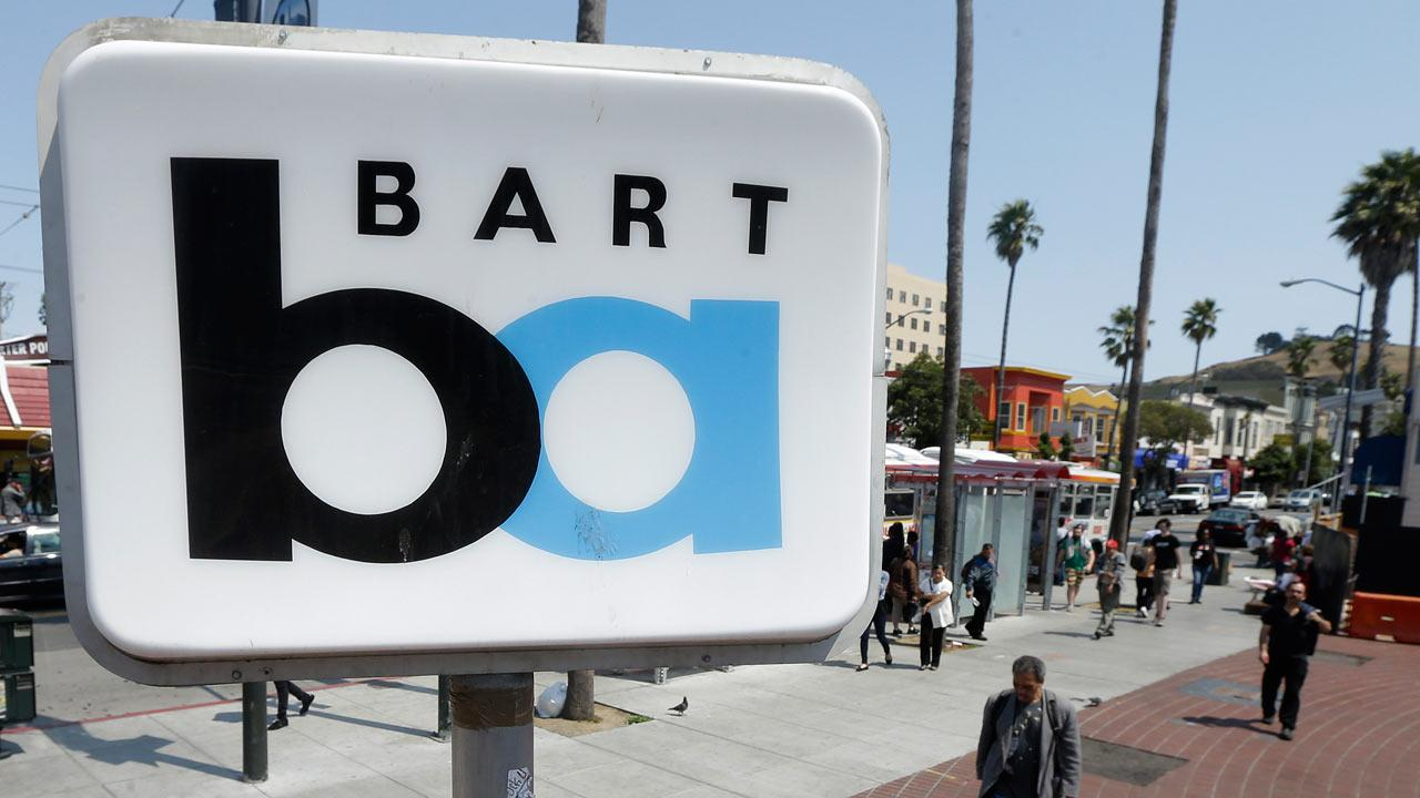 A man walks under a sign for the 24th Street Mission Bay Area Rapid Transit (BART) station in San Francisco, Monday, July 1, 2013. (AP Photo/Jeff Chiu)
