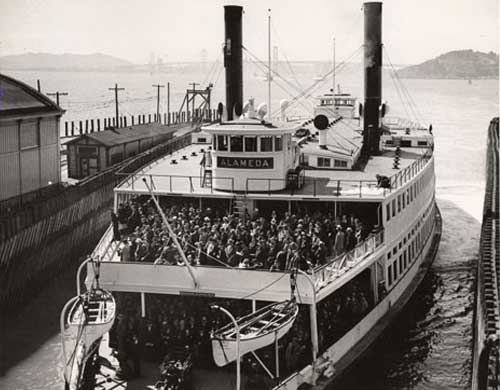 A ferry boat in Alameda with crowded with commuters in 1958. Before the bridge was built the ferry was the primary transportation for commuters between San Francisco and Oakland. (Photo courtesy baybridgeinfo.org)