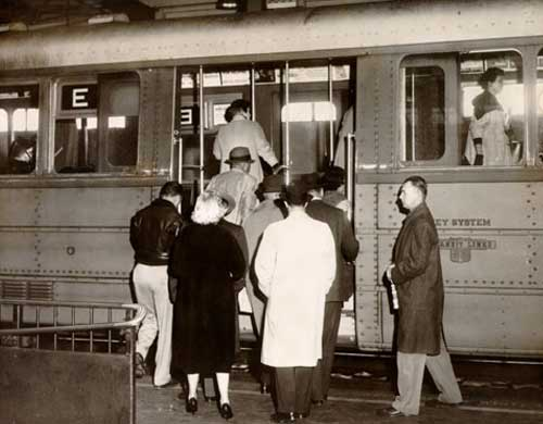Passengers boarding a Key System train in 1958. The Key System consisted of local streetcar and bus lines operating solely in the East Bay, and a network of commuter rail and bus lines connecting the East Bay to San Francisco via the lower deck of the Bay Bridge. (Photo courtesy baybridgeinfo.org)