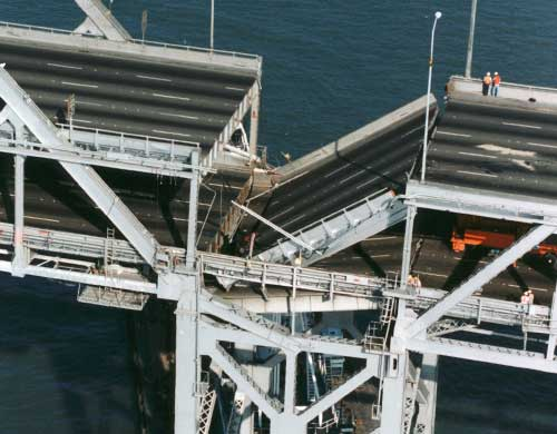 At 5:04 p.m. on October 17, 1989, a 7.1-magnitude earthquake struck the Bay Area. The upper deck at pier E9 on the Bay Bridge failed and crashed into the lower deck, also causing the lower deck to fail. The suspension bridge on the West Span is inherently more flexible and was able to withstand the earthquake. It was the rigid structure of the truss bridge on the East Span that made it more susceptible to failure. (Photo courtesy baybridgeinfo.org)