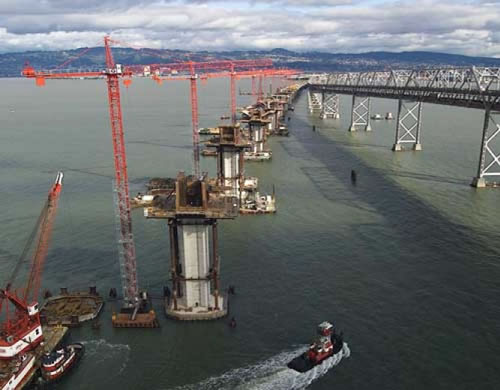 Construction began on the new Bay Bridge. The West Span would be retrofitted through reinforcement and the East Span would be replaced entirely with a new design, including the world's longest Self-Anchored Suspension Span. The new Bay Bridge is scheduled for completion in 2013 and cost an estimated total of $6.3 billion dollars making it one of the largest public works projects in US history. (Photo courtesy baybridgeinfo.org)