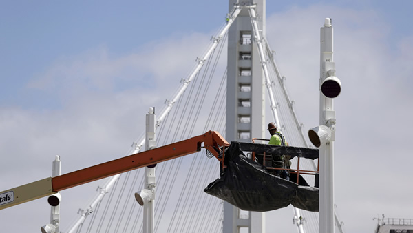 This photo taken Thursday, Aug. 1, 2013 shows a worker on the new eastern section of the San Francisco-Oakland Bay Bridge in San Francisco