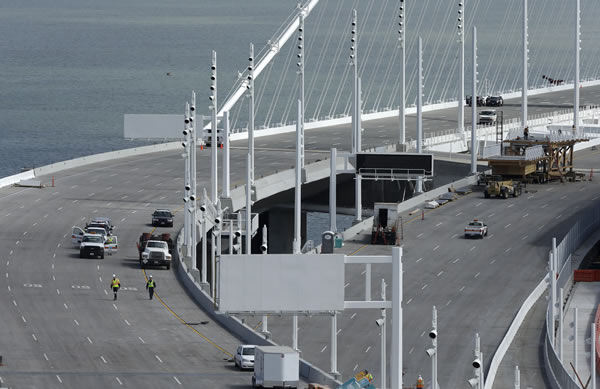 "<div class=""meta ""><span class=""caption-text "">Construction crews work on the new eastern section of the San Francisco-Oakland Bay Bridge in San Francisco, Calif., Thursday, Aug. 29, 2013. Commuters faced their first morning on Thursday without the bridge, but there weren't major traffic snarls as day broke across the Bay Area. Alternate bridges to get into San Francisco were more crowded around 6:30 a.m., and Bay Area Rapid Transit trains appeared to be carrying a heavier load than usual. But commuters were managing to get around. (AP Photo/Jeff Chiu)</span></div>"