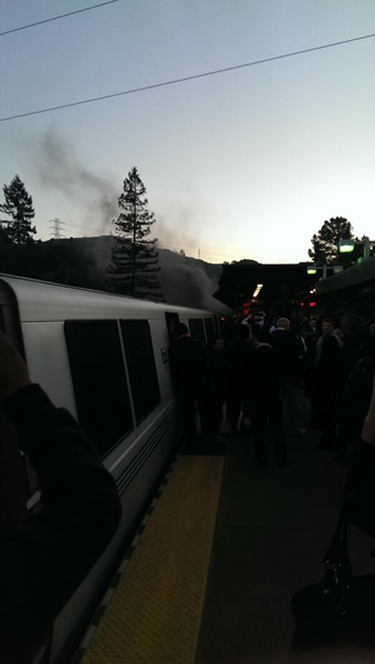 "<div class=""meta image-caption""><div class=""origin-logo origin-image ""><span></span></div><span class=""caption-text"">(Smoke is seen coming from a BART train at the Orinda station (Photo courtesy bipp5/Twitter).)</span></div>"