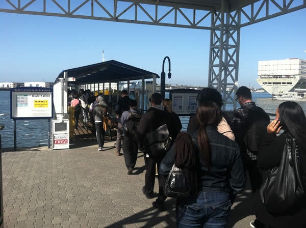 A fire near the West Oakland BART station has disrupted Transbay Tube service.  The photo shows a long line at the Jack London ferry terminal Thursday morning on June 14, 2012. <span class=meta>(submitted via uReport)</span>