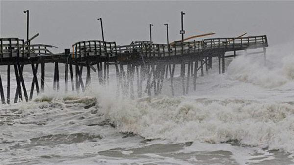 Waves from Hurricane Sandy crash onto the damaged Avalon Pier in Kill Devil Hills, N.C., Monday, Oct. 29, 2012 as Sandy churns up the east coast. Hurricane Sandy continued on its path Monday.