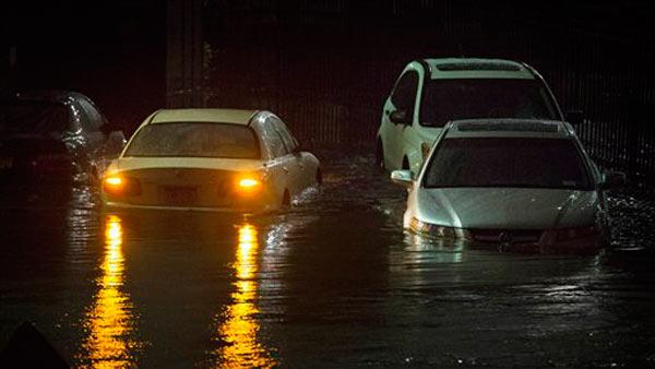 Vehicles are submerged during a storm surge near the Brooklyn Battery Tunnel, Monday, Oct. 29, 2012, in New York.