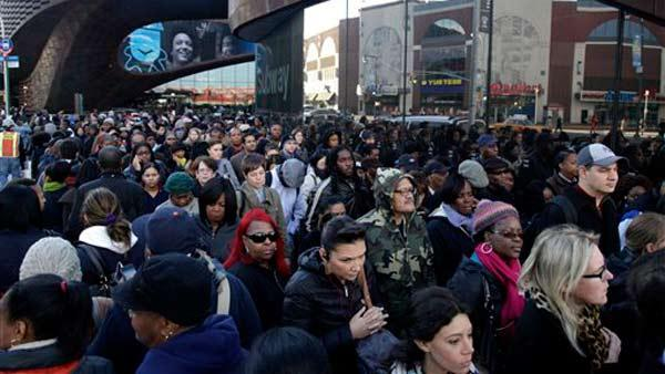 Commuters wait in a line to board buses into Manhattan in front of the Barclays Center in Brooklyn, New York, Thursday, Nov. 1, 2012.