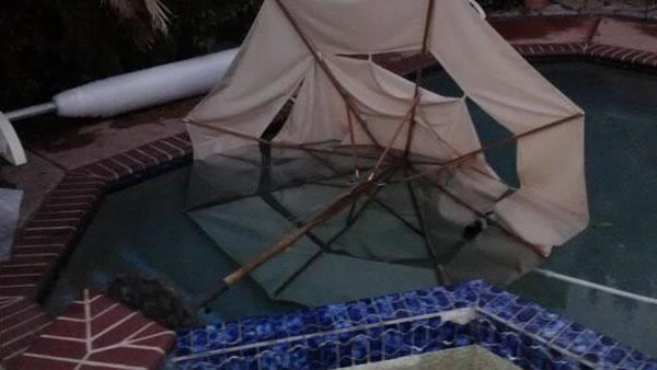High winds swept patio furniture into a swimming pool in San Jose