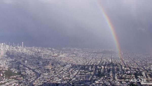 Rainbow stretches across San Francisco after a storm.