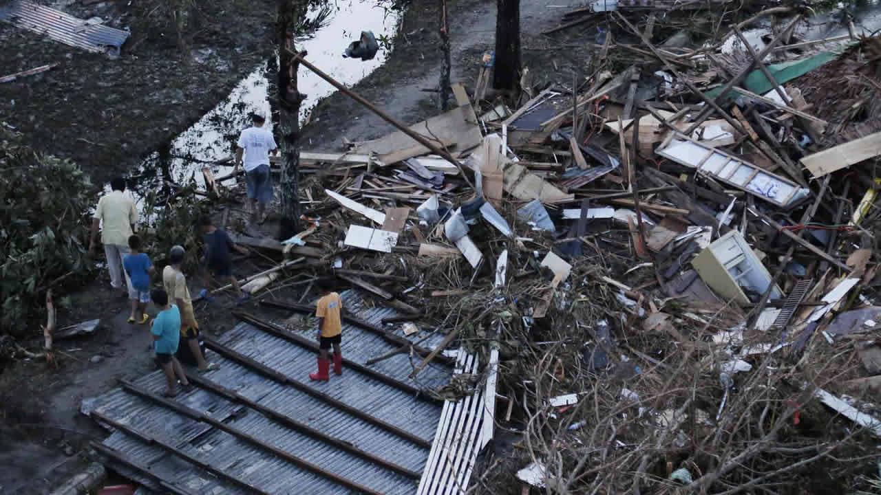 Residents sift through the rubble of their damaged house following a powerful typhoon that hit Tacloban city, in Leyte province, central Philippines Saturday, Nov. 9, 2013