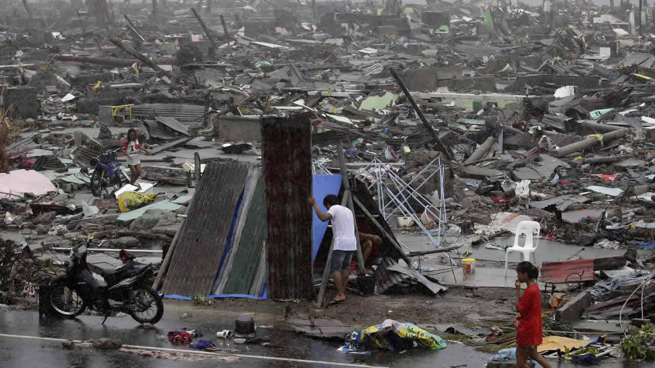 Residents put up a makeshift structure amongst damaged homes in Tacloban city, Leyte province, central Philippines on Sunday, Nov. 10, 2013.