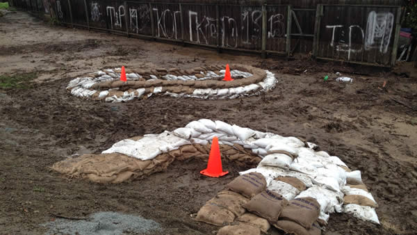 "<div class=""meta ""><span class=""caption-text "">Officials placed sand bags along a creek in Palo Alto after floodwaters chased hundreds out of their homes on Monday.</span></div>"