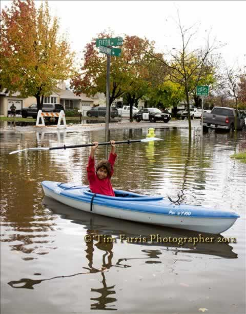 Joshua kayaks in the floodwaters at 5th and Broadway in Redwood City