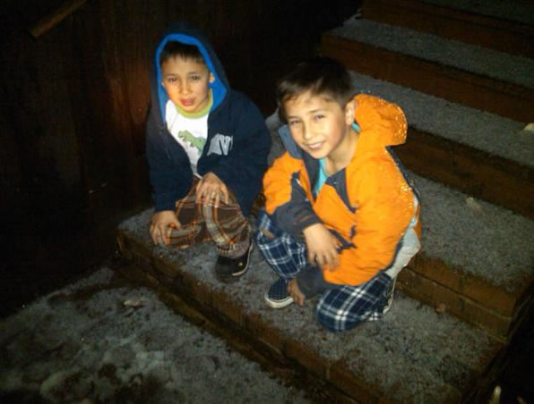 Jameson and Ryan Wang in Berkeley play in the hail. (Photo submitted via uReport)