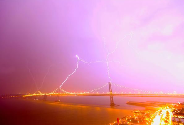 "Here are some images of the lightning and lightning strikes from the storms that passed through the Bay Area Thursday night. This viewer says, ""I was testing my camera and managed to catch this incredible lightning strike on the bay bridge. You can see bolts shooting into and out of all four towers of the west span."" (Photo submitted by Ed Brakus via uReport.)"
