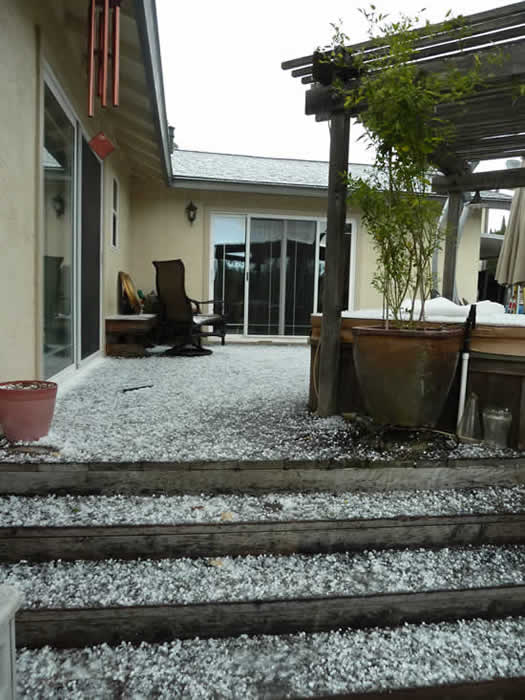 An isolated thunderstorm brings a mix of hail and snow fell in Fairfield and Suisun City today. The planters are outside the county government center. (Photo submitted by Jeanie via uReport)