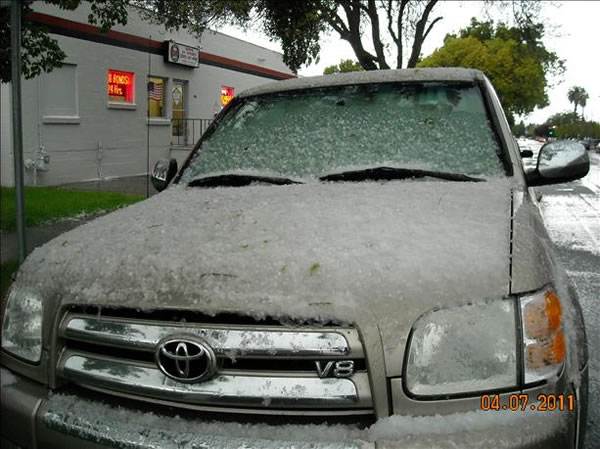 An isolated thunderstorm brings a mix of hail...