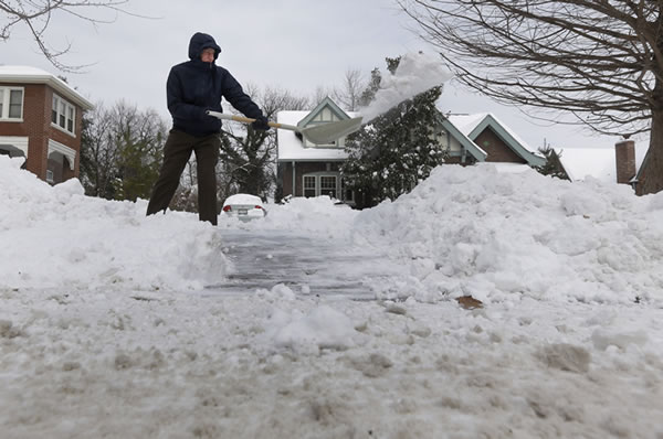 "<div class=""meta ""><span class=""caption-text "">Ralph Wafer clears his driveway of snow outside his home Tuesday, Jan. 7, 2014, in St. Louis. As Missourians muddled through another frigid day Tuesday, the worst cold snap in nearly two decades was about to come to an end but many roads remained partly snow-covered two days after a winter storm dumped several inches of snow. (AP Photo/Jeff Roberson)</span></div>"