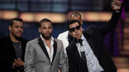 Members of the Latin musical group Aventura collect a Billboard Award for Tropical Album Group of the Year, at the 2010 Billboard Latin Music Awards, in San Juan, Puerto Rico, Thursday April 29, 2010. (AP Photo/Ricky Arduengo)