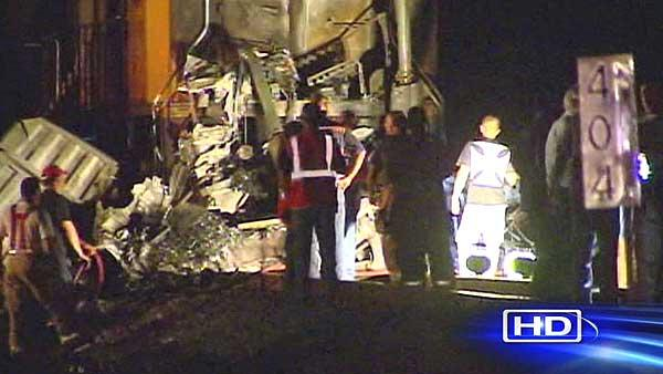 Driver killed when train slams into big rig