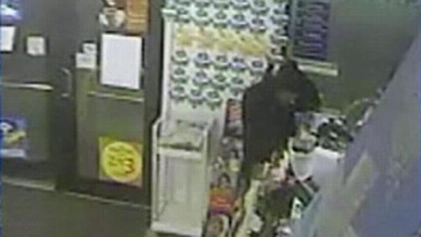 Robber caught on tape having mask trouble