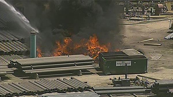 Fire burning at pipe yard in Channelview