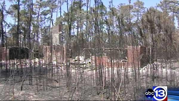 Residents assess wildfire damage