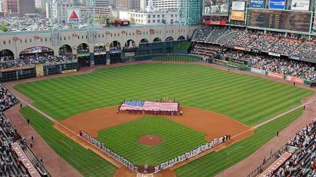 In this file photo, the St. Louis Cardinals, left, and the Houston Astros line up for the national anthem at the Astros baseball season home opener Monday, April 7, 2008, in Houston. (AP Photo/Pat Sullivan)