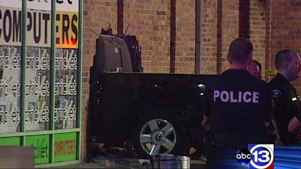 Driver charged after crashing into store, injuring family
