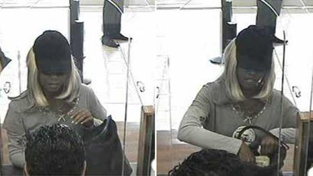 Detectives need help identifying the suspect who robbed a bank in west Houston Tuesday evening. Even though the suspect is dressed like a woman, many witnesses believe it is a man.