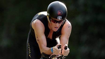 Lance Armstrong competes in the Ironman Panama 70.3. triathlon in Panama City, Sunday Feb. 12, 2012. The race consists of a 1.2-mile swim, a 56-mile bike ride and a 13.1-mile run. (AP Photo/Arnulfo Franco)