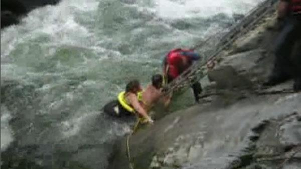Couple saved in waterfall rescue