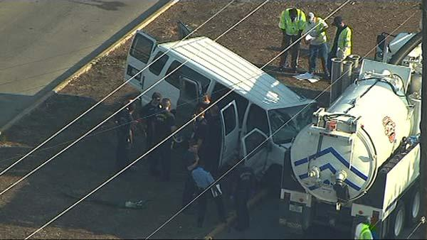 Van slams into city pump truck