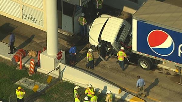 Rig driver crashes at toll booth