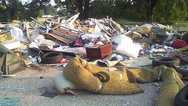 Neighbors fed up with illegal dumping ground