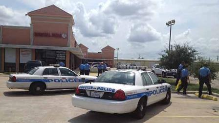 Police at the scene of a shootout outside a north Houston game room