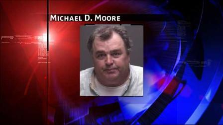 Michael D. Moore, 49, was arrested on Mondy.