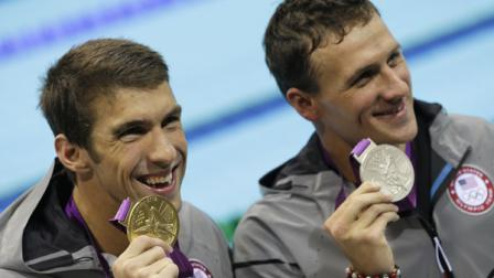United States Michael Phelps, left, and United States Ryan Lochte pose with their medals for the mens 200-meter individual medley swimming final at the Aquatics Centre in the Olympic Park during the 2012 Summer Olympics in London, Thursday, Aug. 2, 2012. Phelps won gold, Lochte silver. (AP Photo/Michael Sohn)