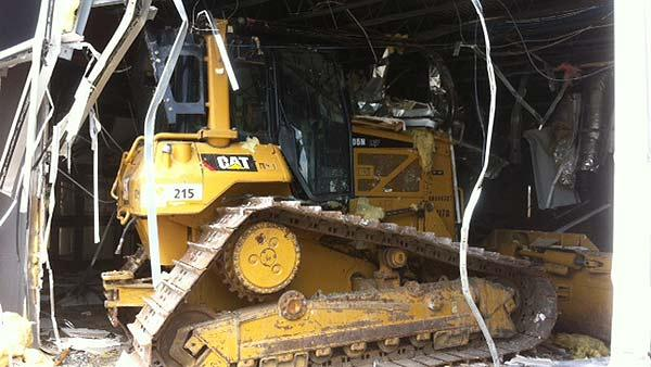 Police: Disgruntled employee drives bulldozer into building
