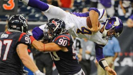 Minnesota Vikings quarterback McLeod Bethel-Thompson (4) dives over Houston Texans Shawn Loiseau (90) during the second half of an NFL preseason football game against the Houston Texans, Thursday, Aug. 30, 2012, in Houston. The Texans won 28-24.(AP Photo/Dave Einsel)