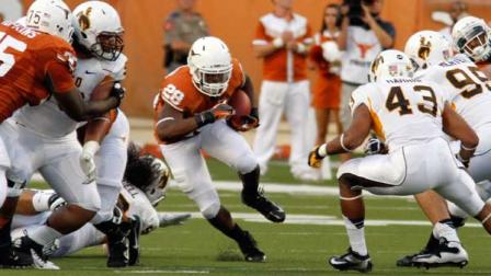 Texas running back Malcolm Brown runs for yardage during the first quarter of an NCAA college football game against Wyoming, Saturday, Sept. 1, 2012, in Austin, Texas.(AP Photo/Jack Plunkett)