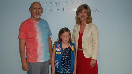 (From left to right) Anthony Victorino, Jr., Maggie Miksch and Mary Vitek, CEO for Girl Scouts of San Jacinto Council. Maggie, age 7, received the Girl Scout Medal of Honor for saving the life of her grandfather Anthony. Lifesaving Awards recognize Girl Scouts from 5-17 years of age who have heroically saved or attempted to save a life.  Maggie is only one of 13 girls in the nation to receive this prestigious award this year.