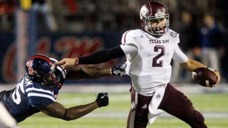 Texas A&M quarterback Johnny Manziel (2) tries to fend off Mississippi defensive end Cameron Whigham (55) during the second quarter of an NCAA college football game in Oxford, Miss., Saturday, Oct. 6, 2012. (AP Photo/Rogelio V. Solis)