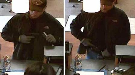 The FBI says this armed man robbed a north Houston bank on the day after Christmas, and they need your help identifying him.