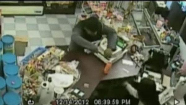 Clerk with gun stops knife-wielding robber