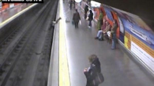 Woman saved after falling onto train tracks