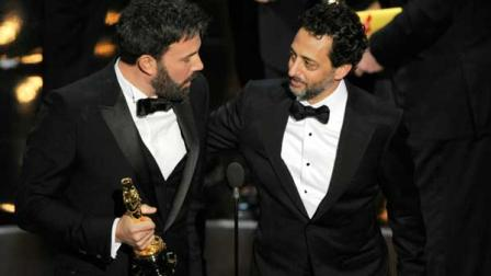 Director/producer Ben Affleck, left, and producer Grant Heslov accept the award for best picture for Argo during the Oscars at the Dolby Theatre on Sunday Feb. 24, 2013, in Los Angeles. (Photo by Chris Pizzello/Invision/AP)