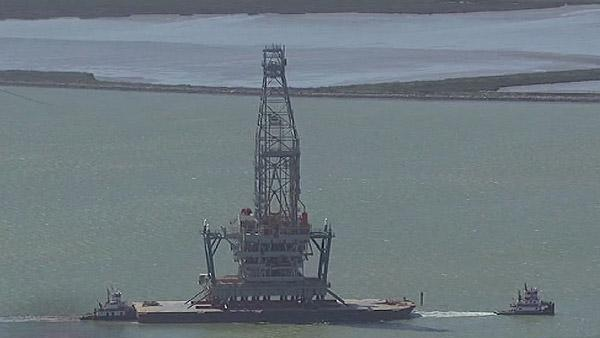 Aerials of huge oil platform being moved